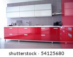 close up shot of a red modern kitchen with cabinet and drawers - stock photo