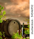 Red wine with old wine barrel on background of vineyard landscape with dramatic evening sky - stock photo