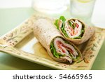 healthy turkey wrap sandwich with lettuce, tomato, onion and peppers - stock photo