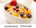 A fiber rich rich breakfast complete with fresh and dried fruits - stock photo