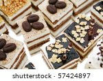 Colorful small fruity and chocolate desserts - stock photo
