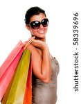 Beautiful young woman holding shopping bags - stock photo