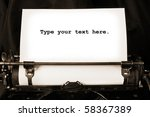 Old type writer with a blank sheet of paper - stock photo