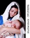 Mary holding  Baby Jesus - stock photo