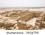 Ruins at Qumran with Dead Sea in deep background - stock photo