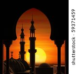 Fireball sunset behind two minarets - stock photo