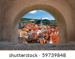 Cesky Krumlov from loop-hole from castle wall - stock photo