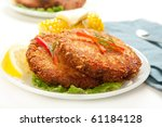 Large dinner sized salmon croquettes served with corn - stock photo