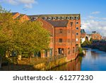Old building in Leeds, near the riverside in autumn - stock photo