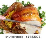 Carving a roast turkey for christmas or thanksgiving - stock photo