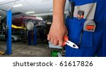 Auto mechanic closeup standing in his workshop - stock photo