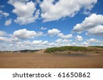 Plowed field under the sky - stock photo