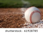 Baseball in the infield near the chalk line - stock photo
