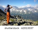 Traveler girl looking to far mountains - stock photo