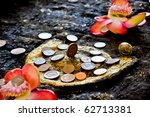 Coin donation in the Buddha's footprint,Sangkhlaburi, Kanchanaburi  , Thailand - stock photo