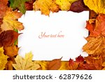 Colorful frame of fallen autumn leaves with text message - stock photo