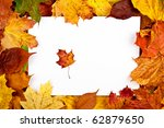 Colorful frame of fallen autumn leaves and a small leaf in a frame - stock photo