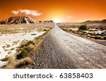 sunset desert landscape with road - stock photo