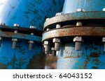 Industrial blue pipelines joint with bolts and joints - stock photo