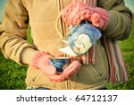 A girl pouring tea outside - stock photo