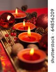 Red Christmas festive candles with Christmas balls and walnuts - stock photo