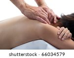 young woman's back with male hands massaging her neck - stock photo