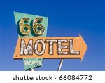 Old rusted Route 66 motel sign in front of an abandoned motel - stock photo
