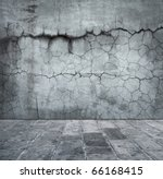 Grungy distressed stone wall and floor with large cracks. - stock photo