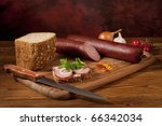 Composition with sausage on the table - stock photo