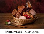 Composition of different sorts of meat on the table - stock photo