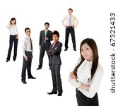 Young business woman and her team over white background, focus on woman in front. - stock photo