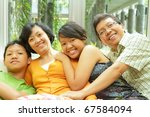Togetherness of happy Asian ethnic family - stock photo