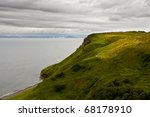 Isle of Skye, Scotland - coast with many sheep on hills - stock photo