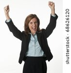 Business woman cheering with her arms raised - stock photo