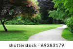 Winding Path in a Peaceful Landscape Garden - stock photo