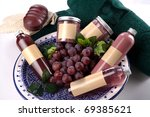 Spa accessories and grapes placed on a plate, with towels on the side - stock photo