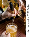 pouring a glass of beer - stock photo