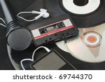 Microphone, vinyl discs, audiotape, mp3 player, cd over black - stock photo