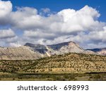 An imposing natural formation with steep-sided peaks, Battlement Mesa, Colorado - stock photo