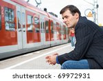 Business man wait for a train - stock photo