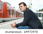 Business man waiting for a train - stock photo