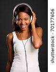 Lovely smile by beautiful black woman music fan - stock photo