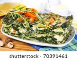 Lasagna garnished with rosemary - stock photo