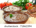 Indian dish with beans, lentils and tomato - stock photo