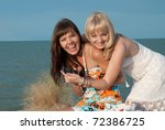 beautiful happy young girls arrived with the bags on the beach - stock photo