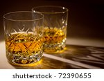 two cut crystal whisky glasses with whisky - stock photo