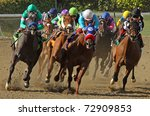 "ARCADIA, CA - MAR 5: Jockeys storm down the homestretch in a claiming race at Santa Anita Park on Mar 5, 2011 in Arcadia, CA. Eventual winner is ""Lutess"" (grey roan at left.) - stock photo"
