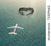 flight above heart-shaped tropical island - stock photo