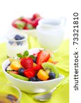 Breakfast- fresh salad with fruits and berries, tea and yogurt - stock photo