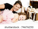 Mother of toddler ballet girl lying on the floor - stock photo